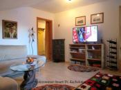 Wohnzimmer TV Kachelofen